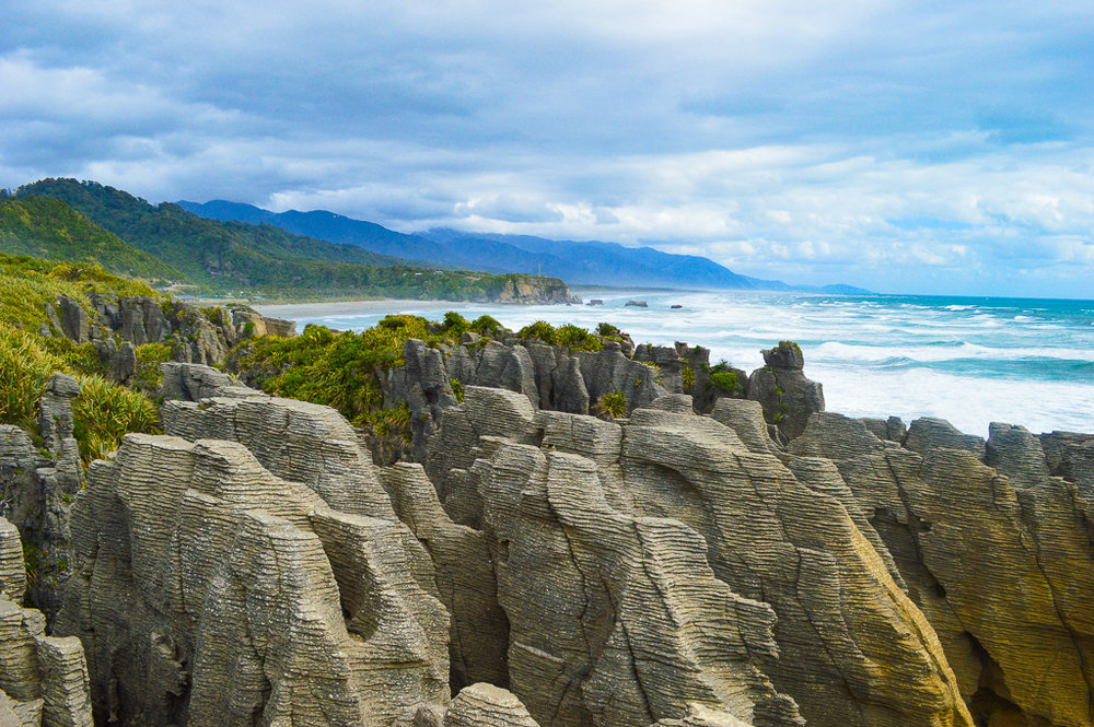 layered geological rock formations in New Zealand