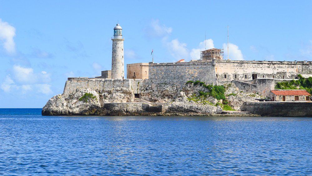 lighthouse and fort in front of the sea in Cuba