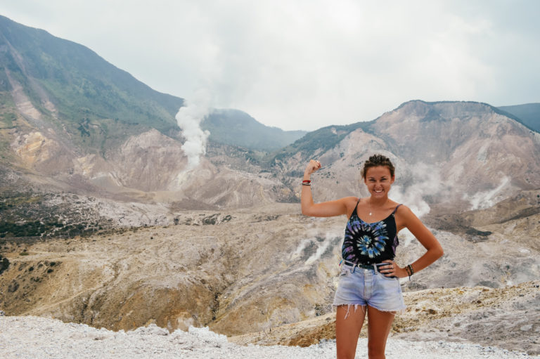flexing muscle on top of active volcano