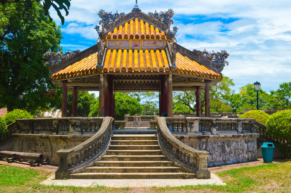 ornate pagoda with sweeping staircase and orange tiled roof
