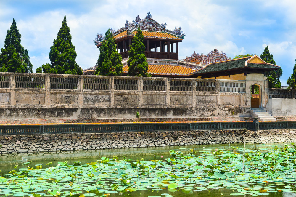 waterlilly pond with ancient palace in background