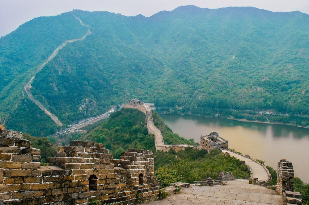 crumbling great wall of chine with a lake reflecting the sunset