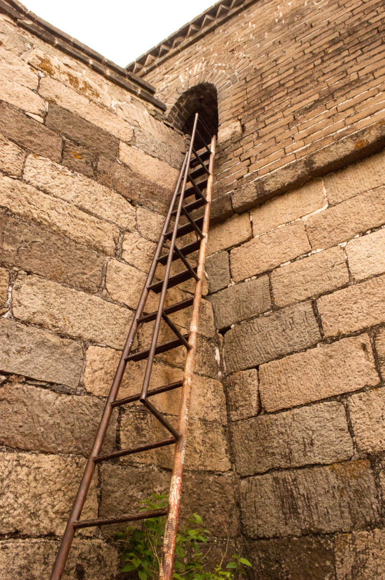 metal ladder leading up the great wall of china