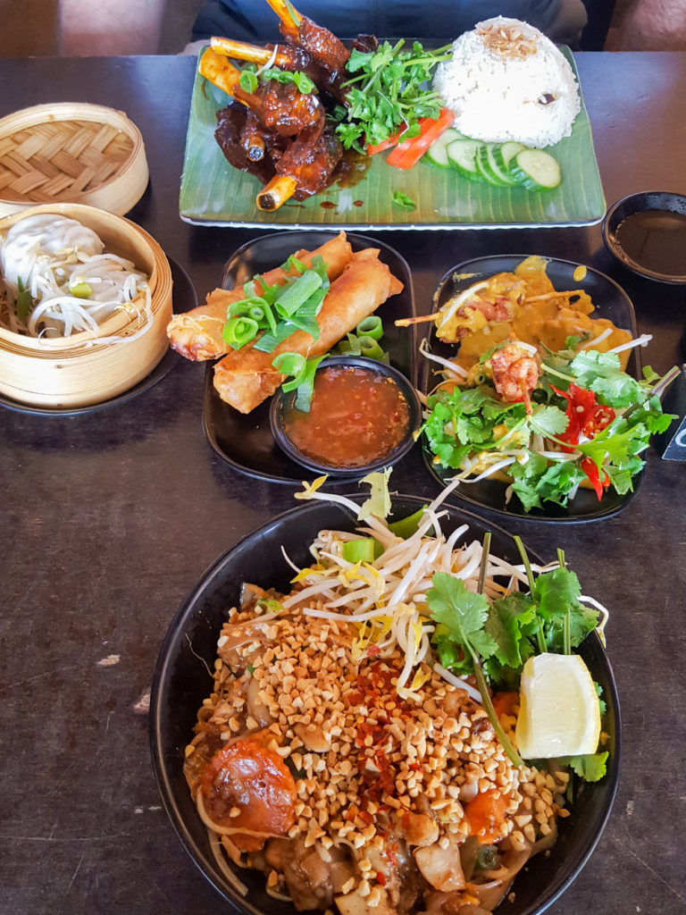 colourful asian food on a wooden table