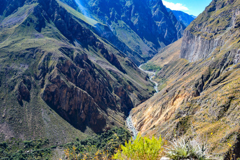 river surrounded by the colca canyon