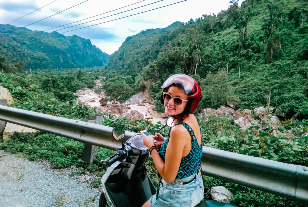 girl on motorbike travelling in Asia