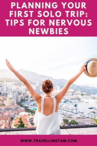 solo travel girl with arms in air pinterest graphic