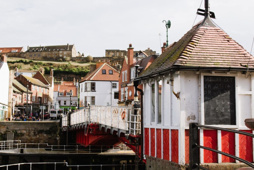 historic buildings and white bridge in Whitby