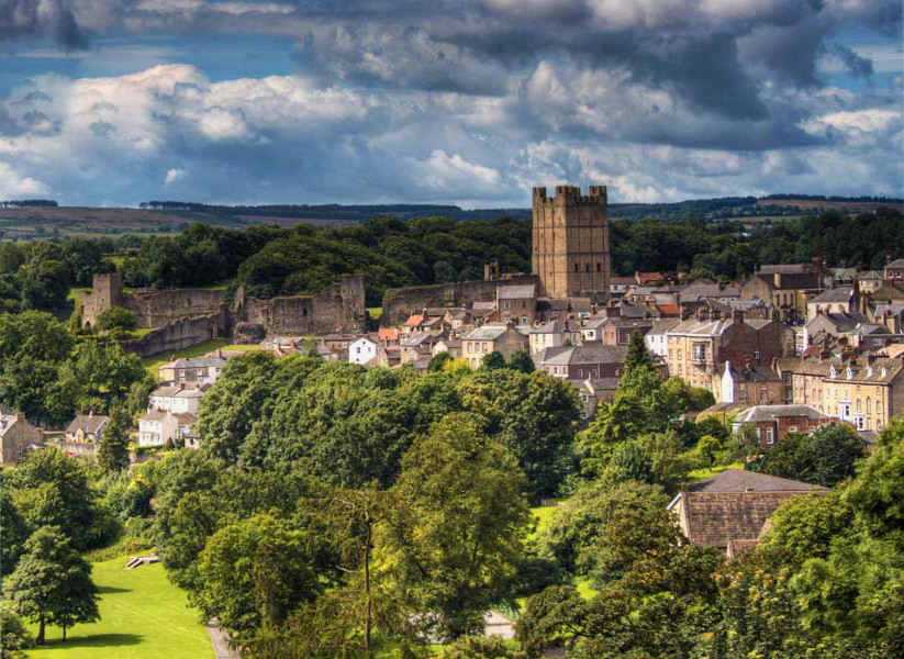 richmond castle and town with trees in foreground
