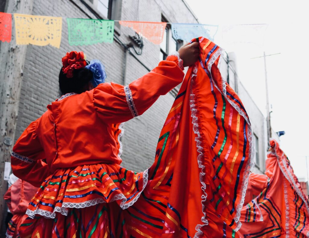 Mexican festival with lady wearing red dress