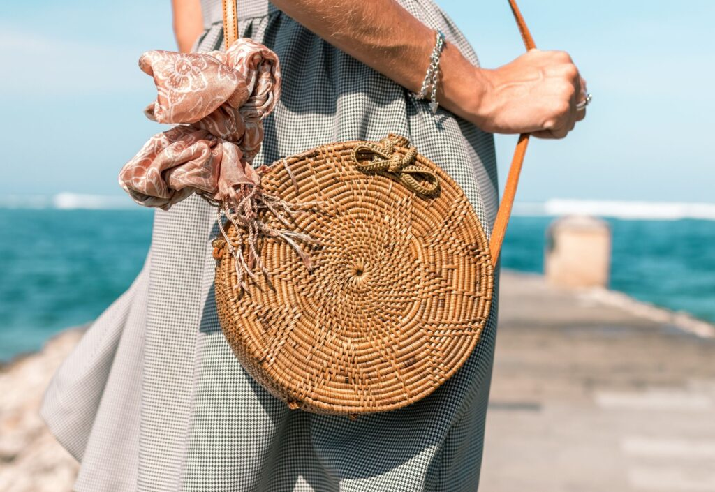lady on beach with basket bag