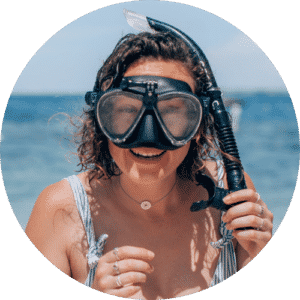 smiling girl in swimsuit with snorkel on