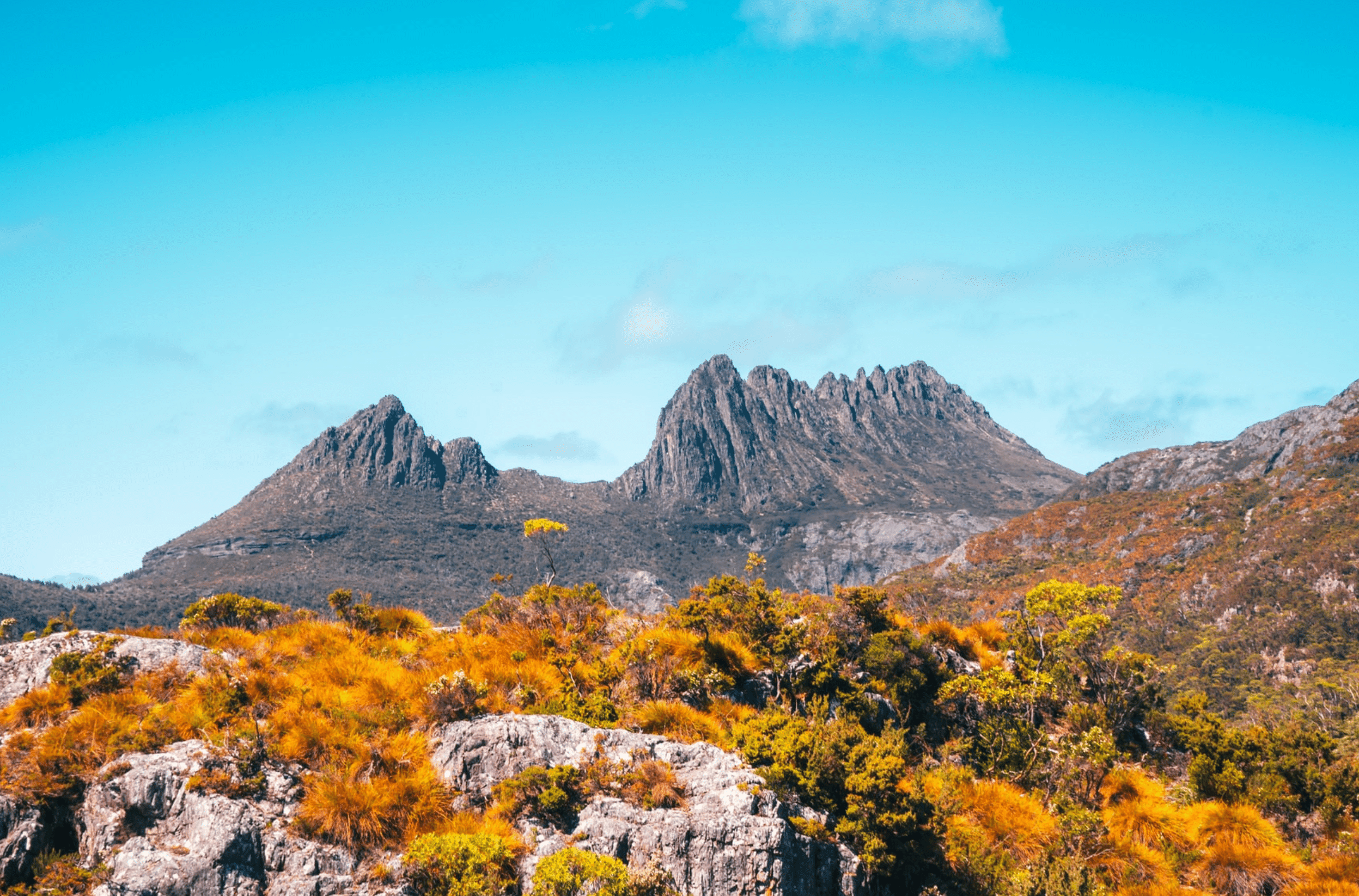 Cradle Mountain with green and orange foliage