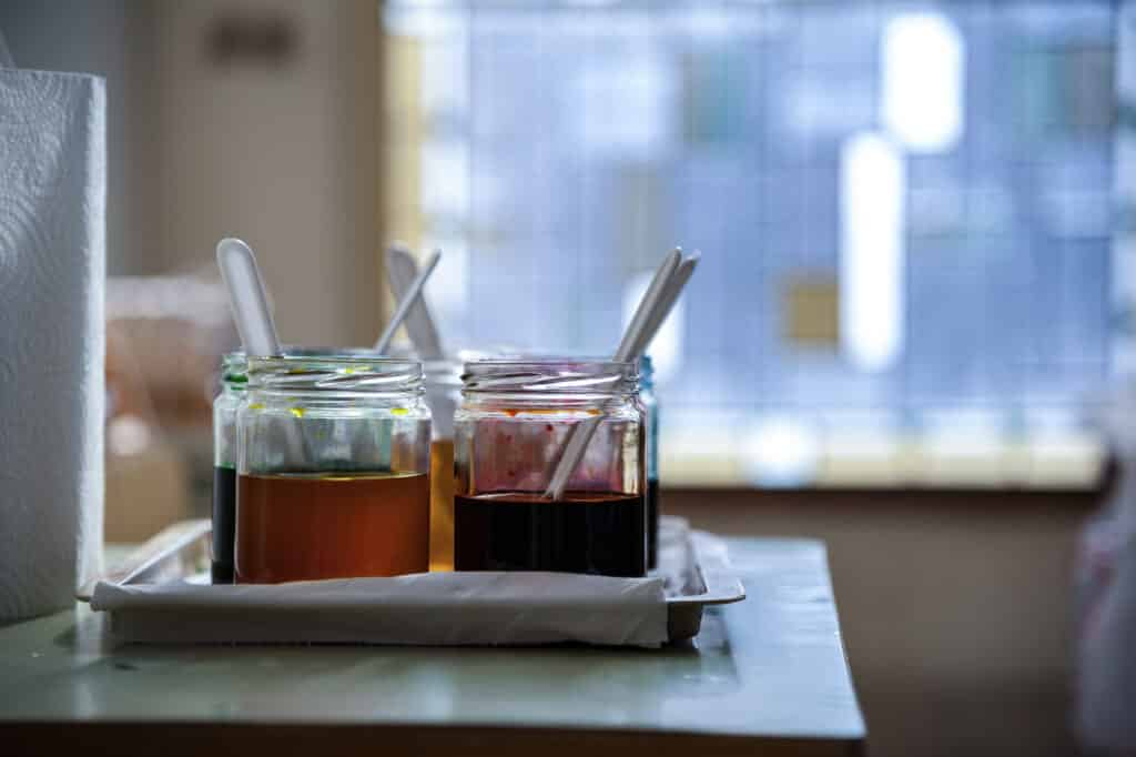 tray with pots of honey samples