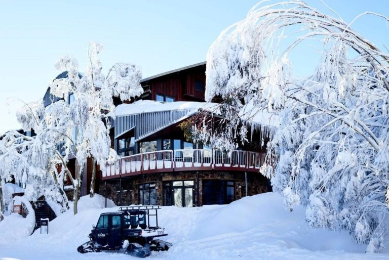 large alpine loge covered in white snow